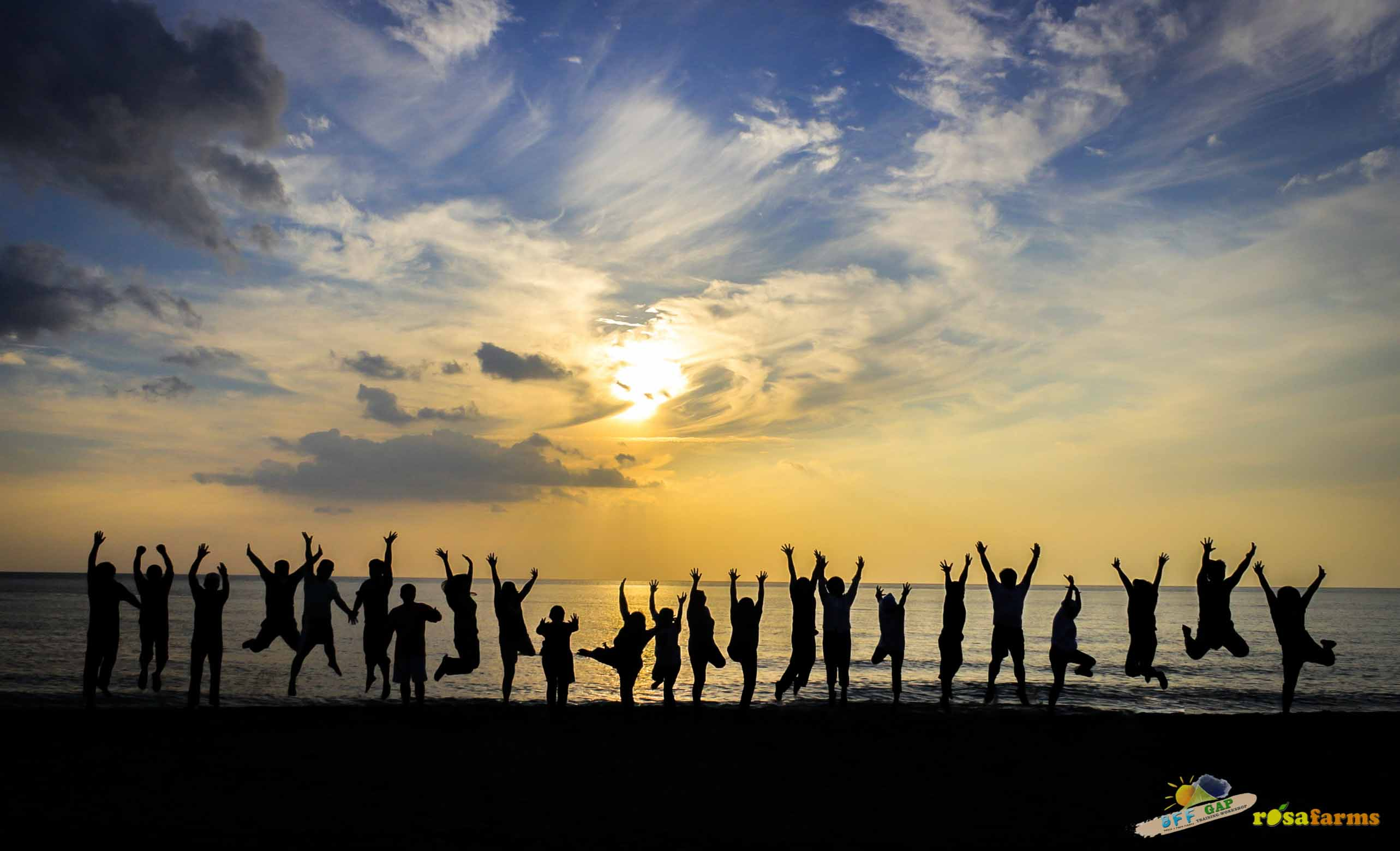Teambuilding photo of Batch 3 with the glorious sunset at Crystal Beach as back drop